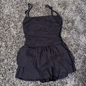 NWOT one piece super cute and slimming size 8!